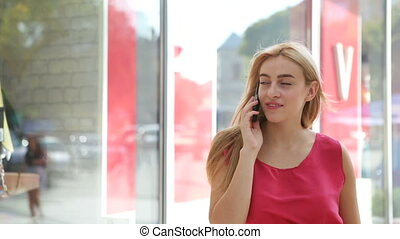 A very pleasant woman using her mobile phone on the street