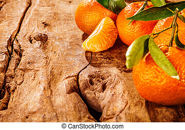 Fresh healthy home grown tangerines or clementine on an old...