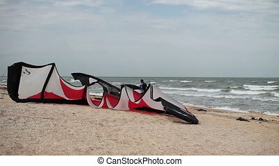after kitesurfing at windy day - man after kitesurfing at...