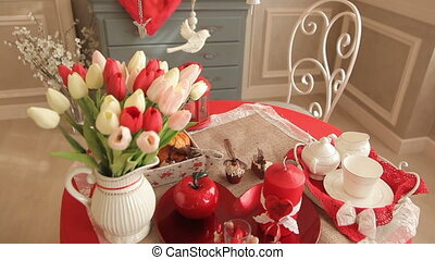 Beautiful romantic room, on a table with a vase of tulips,...