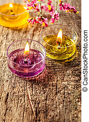 Vertical candle image on wooden background. Three...