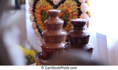 chocolate fountain with fruits on party