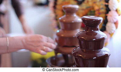 delicacy with fruits and chocolate - chocolate fountain with...