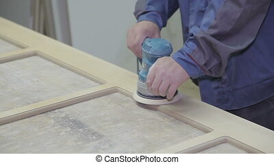 Sanding the Wood, close up footage - Wood worker is sanding...