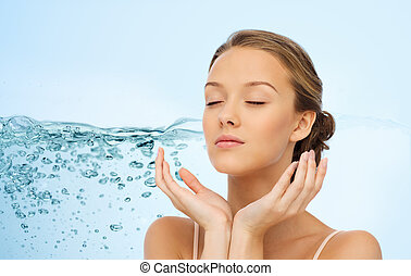 young woman face and hands - beauty, people, moisturizing,...