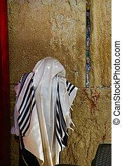 A Man praying at the Western Wall - A Jewish man praying at...