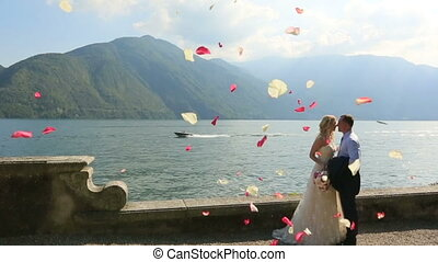 Just Married Kissing in the Rain of Rose Petals.