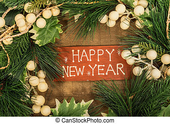 happy new year written on wooden background