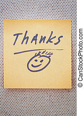 Thanks - Adhesive note with Thanks text on a bulletin board
