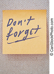 Do not forget written on a lable - Adhesive note with Do not...