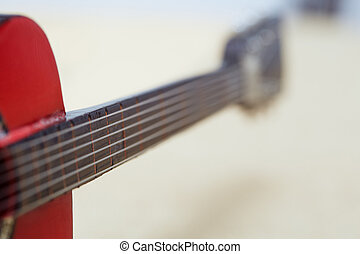 Acoustic guitare. Close-up view with shallow depth of field