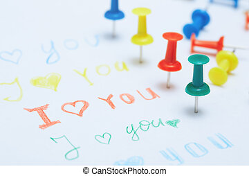 Love you letter with colorful push pins