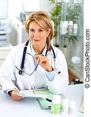 Mature doctor woman with pills. - Mature doctor woman in a...