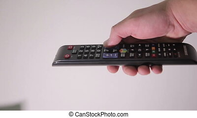 Man Using the TV Remote