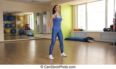 young athletic woman trains in gym