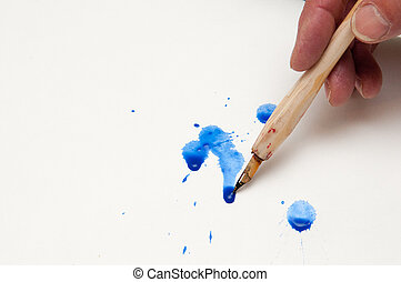 spilt ink - calligraphy pen with blue spilt ink on white...