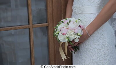 Wedding Bridal Bouquet - Bride in traditional white wedding...