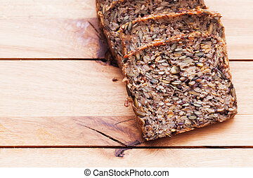 Wholemeal, wholewheat bread on wooden table. Organic,...