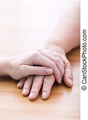 Gesture of support and care - Touching hands - gesture of...