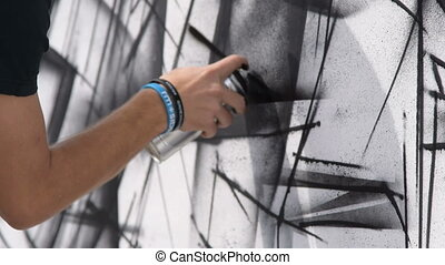 Black and white graffiti - Close-up shot of man drawing...