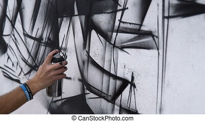 Street graffiti in black and white colors - Man artist...