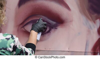 Drawing graffiti portrait - Female graffiti artist drawing...