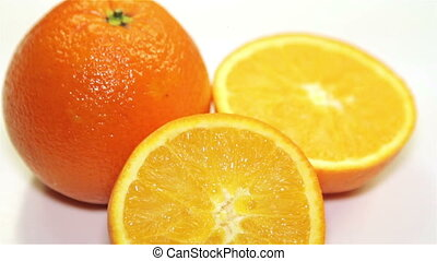 orange rotation on the table, close-up - Healthy Orange with...
