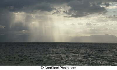 sun rays over the sea - Dark clouds with sun rays over...