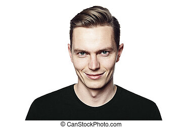 Man with ironic smile - Studio shot of young man smiling to...