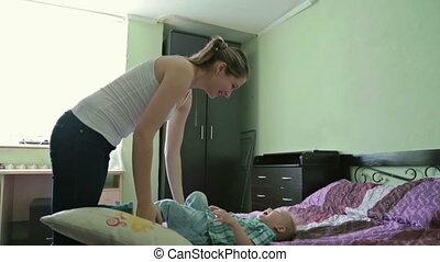 Mother and son have fun in bed. - Mother and son have fun in...