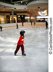 Young boy learning to skate - Winter time. Young boy...