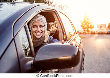 Woman driving a car - Beautiful young blond woman driving a...