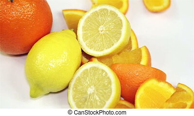 orange and lemon rotation on the table, close-up - Healthy...