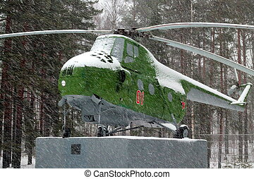 USSR old Mi-4 helicopter on the pedestal in the snow