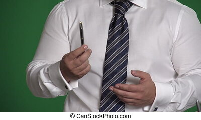 Gesture male hand with a pen on a green background 2 -...