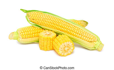 Two whole and pieces of ripe corn on the cob with green...