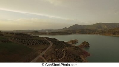 4K Aerial, Flight over barrier lake - Different approaches,...