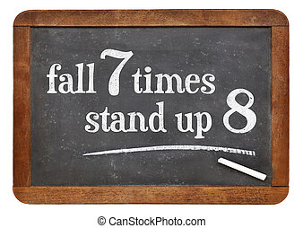 Japanese proverb on blackboard - Fall seven times, stand up...