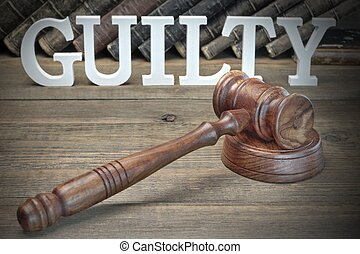The Jury Verdict Concept. Sign Guilty, Judges Gavel And Old...
