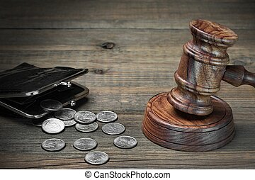 Gavel, Empty Purse, Coins, And Old Book On Wooden Table