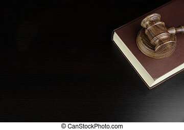 Judges Or Auctioneers Gavel And Red Book On Black Table -...