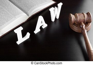 Judges Gavel, Red Book And Sign LAW On Black Table
