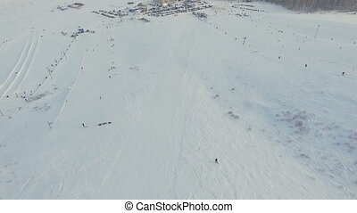 Skier goes down the slope.