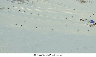 Flight towards snow tubing track Aerial shot