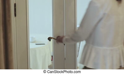 Girl opens beautiful classic door, enters the room - Girl...
