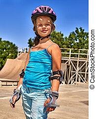 Girl riding on roller skates . - Portrait of sport girl...