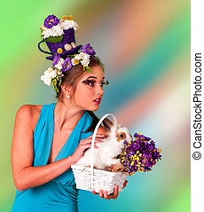 Woman in easter style look up with bunny.