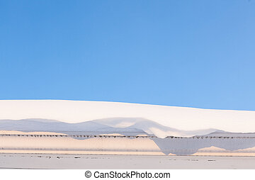 Gutter and roof full of snow in winter