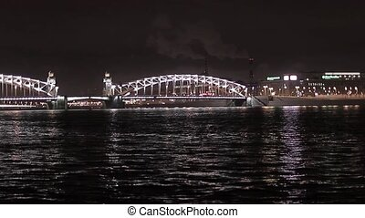 View of bridge and river in night city.  Illumination.