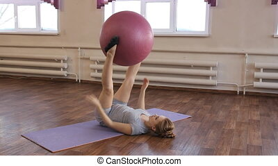 young pregnant woman doing gymnastic